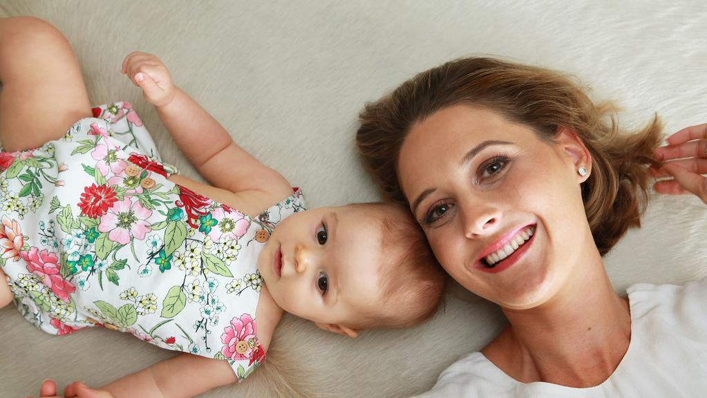 Kimberley Busteed poses with her baby daughter Evie at their Brisbane home. Picture: Claudia Baxter