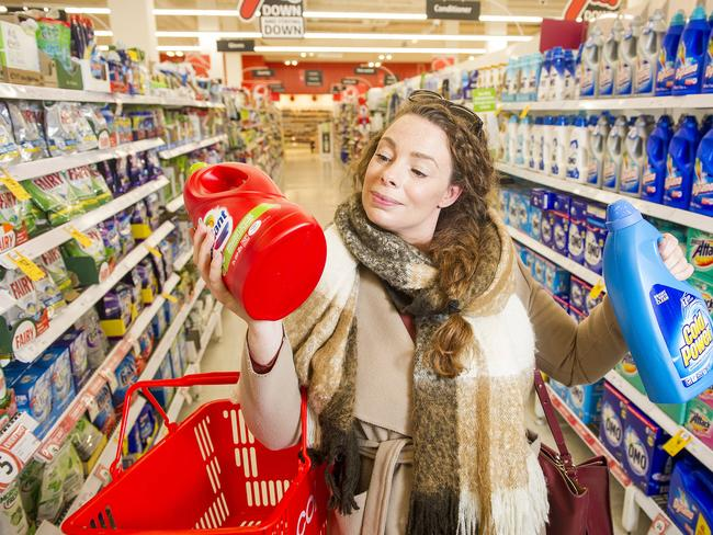 Unit pricing. Shoppers at Coles on Swan Street in Richmond checking unit prices to save on grocery bills.  Lizzie Chennell checking the price in the laundry isle. Picture: Eugene Hyland