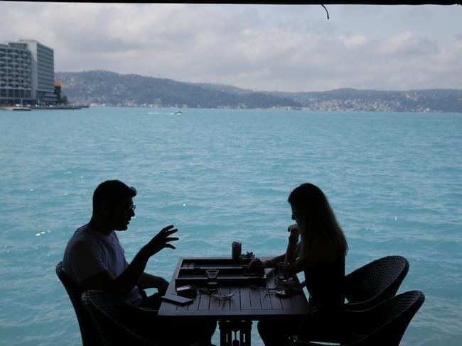 Diners take advantage of the picturesque setting of Bosporus Strait. Picture: AP/Lefteris Pitarakis