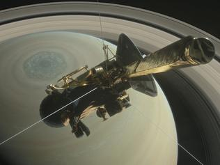 This artist's rendering shows NASA's Cassini spacecraft above Saturn's northern hemisphere, heading toward its first dive between Saturn and its rings on April 26, 2017. Credits: NASA/JPL-Caltech
