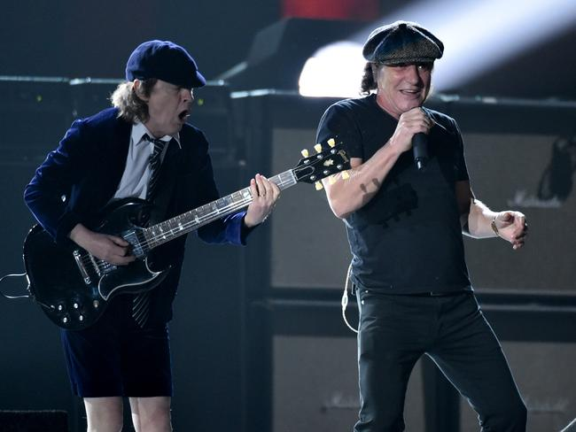 School of rock ... Angus Young, left, and Brian Johnson, of AC/DC set things off. Picture: John Shearer/Invision/AP