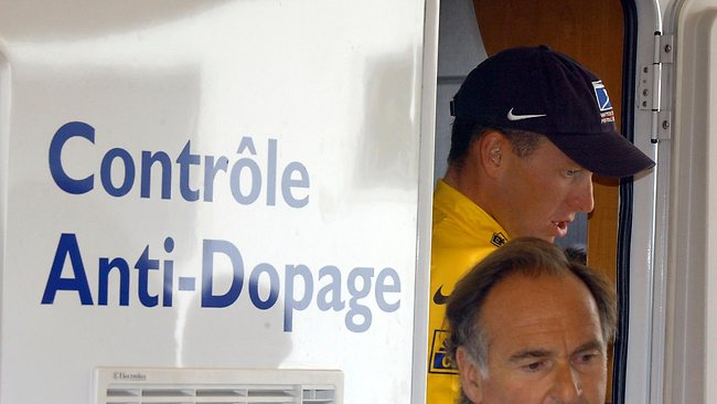 Armstrong walks out of the Tour de France's anti-doping control bus.