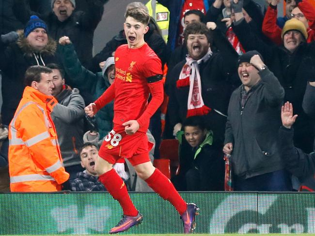 Liverpool's Ben Woodburn celebrates scoring his side's second goal against Leeds, becoming the club's youngest ever goalscorer.