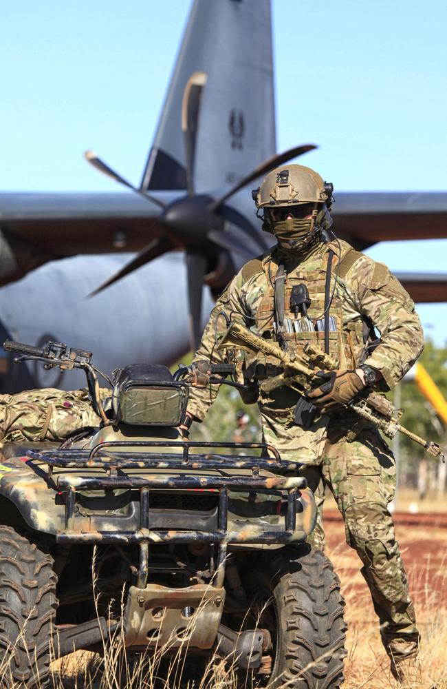 On guard ... A soldier prepares for a training mission at the Delamere Range Facility in the Northern Territory during last mont's Exercise Pitch Black. SAS troops will reportedly be deployed to Iraq to protect relief aircraft while on the ground in combat zones. Source: Defence