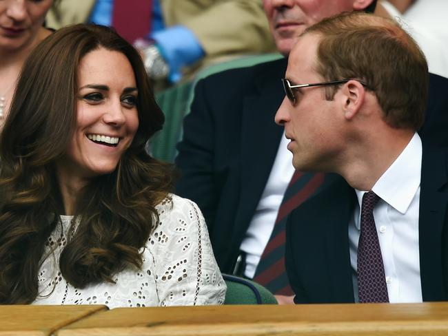 Happy couple ... Kate and William at Wimbledon last month.