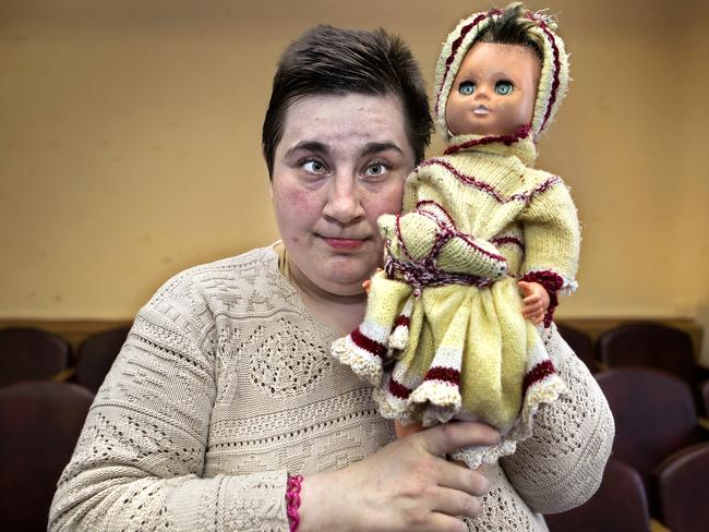 This resident is seen clutching a beloved and worn doll. Picture: Jadwiga Bronte
