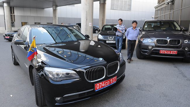 Two cars of the Ecuadorian embassy are parked at Moscow Sheremetevo airport on June 23, 2013. Former US spy Edward Snowden arrived on June 23, 2013 in Russia from Hong Kong, reportedly on his way to Venezuela, escaping the clutches of US justice after leaking sensational details of cyber-espionage by Washington. Snowden, the target of a US arrest warrant issued on June 21, 2013 after he blew the lid on massive secret surveillance programmes, arrived in Moscow on a direct flight operated by Russian flag carrier Aeroflot. AFP PHOTO / VASILY MAXIMOV