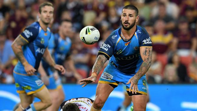 Nathan Peats of the Titans (right) passes the ball during Round 7 against the Broncos. Photo: AAP