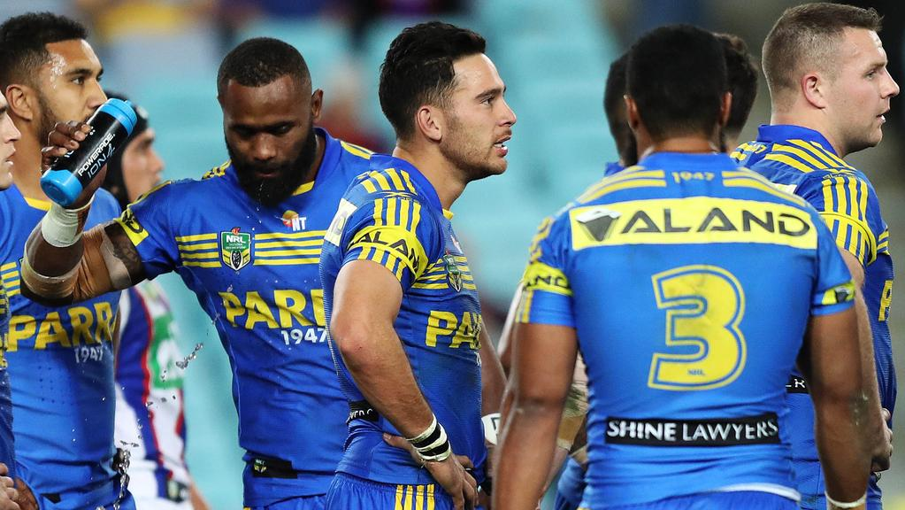 Parramatta players look on after a Newcastle try. Picture: Brett Costello