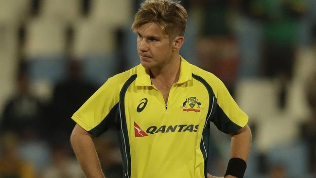Adam Zampa looks dejected after being hit to the boundary.