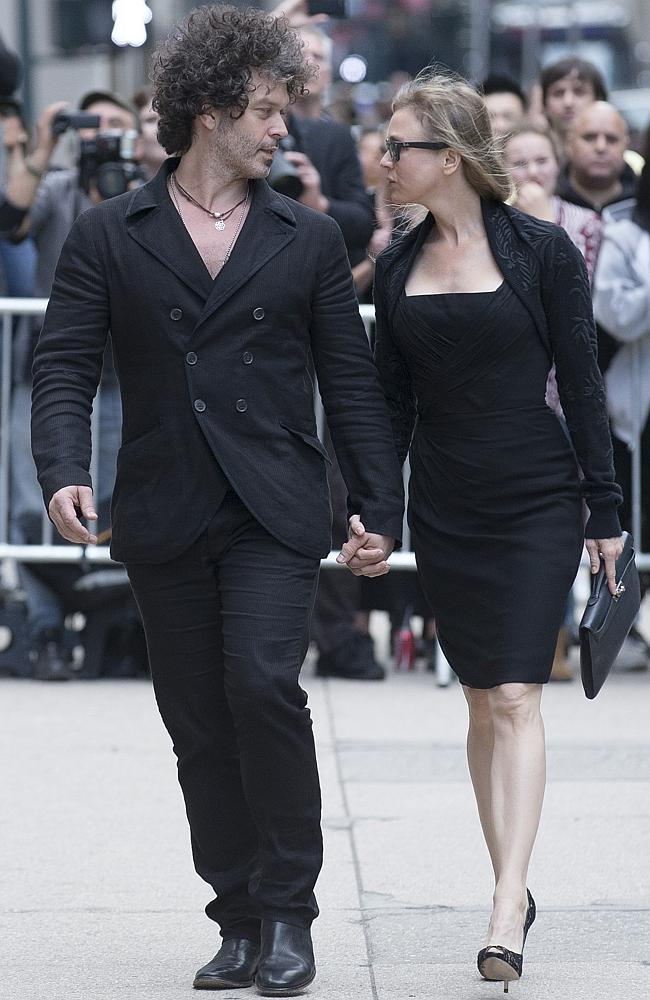Bridget Jones ... Renée Zellweger, right, and Doyle Bramhall arrive at St Bartholomew's C