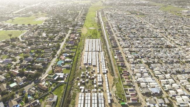 Nomzamo/Lwandle borders the communities of Strand and Somerset West, about 40km east of Cape Town. Picture: Johnny Miller/Millefoto/Rex Shutterstock