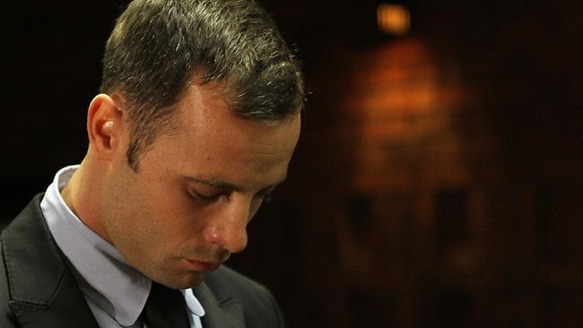Olympic athlete Oscar Pistorius looks down in court during his bail hearing in Pretoria. Detective Hilton Botha has revealed that police found testosterone and syringes in Pistorius's home on the morning Reeva Steenkamp was gunned down.