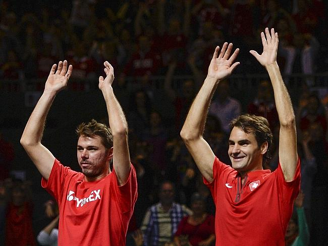 Stanislas Wawrinka, left, and Roger Federer, right, have set up the first all-Swiss ATP final since 2000.