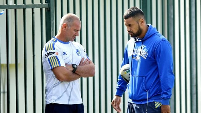 Coach Brad Arthur talks to Kenny Edwards before Parramatta training.