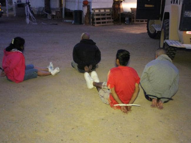US Homeland Security images of people arrested for trafficking drugs from Mexico to Arizona in 2011.