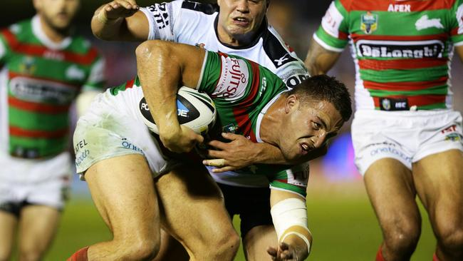 South Sydney's Sam Burgess on his way to scoring a try.