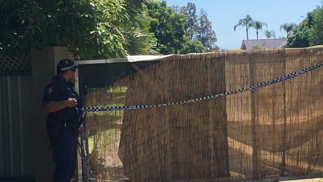 Police at the scene of a shooting at Carrara where a man died. Photo: Nick McElroy