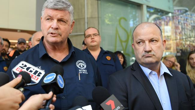 RTBU NSW Secretary Alex Claassens (left) and Secretary of Unions NSW Mark Morey are seen leaving a meeting with Sydney Trains in Sydney. Picture: AAP Image/David Moir.