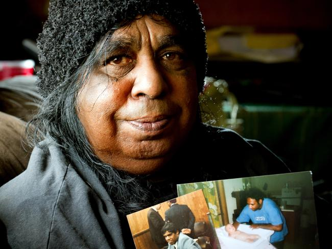 Beverly Whyman, a Stolen Generation mother, with photos of her two boys, Russell and Kelvin, who were removed from her care.