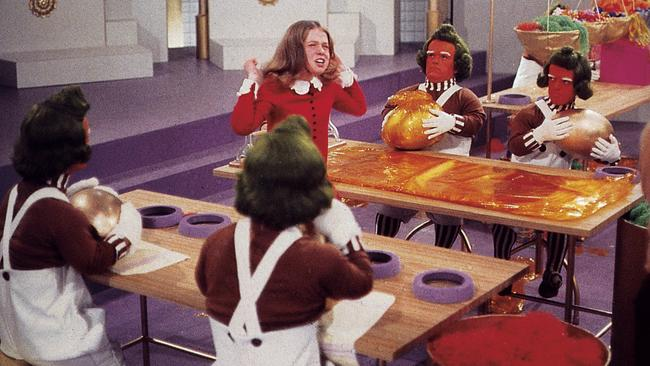 Mischief-makers ... a film still showing Veruca Salt with the Oompa Loompas in Willy Wonka and the Chocolate Factory. Picture: Supplied
