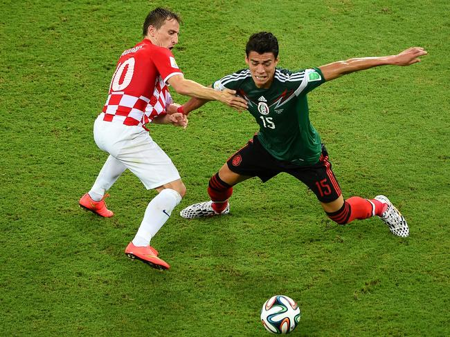 Luka Modric of Croatia and Hector Moreno of Mexico compete for the ball.