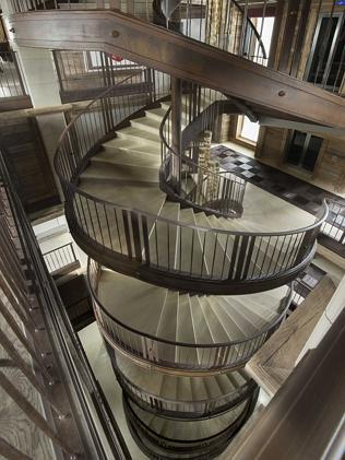 A magnificent spiral stairway provides access to all levels as well as a lift.