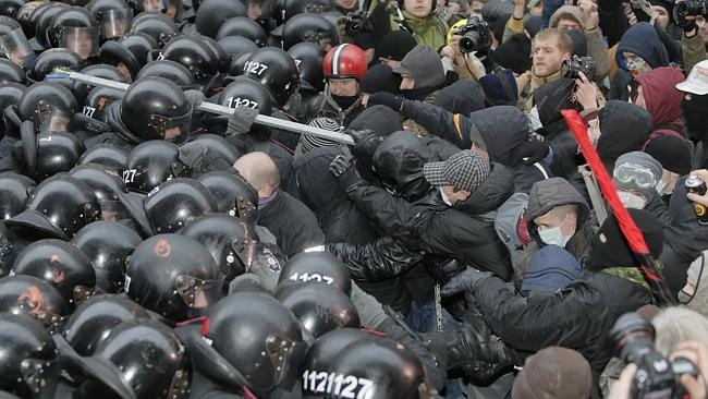Ukraine goes head on ... Protesters clash with police at the presidential office in Kiev on December 1. Picture: AP Photo/Efrem Lukatsky