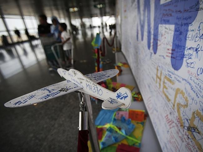 A foam plane with messages and cards with personalised messages dedicated to people invol