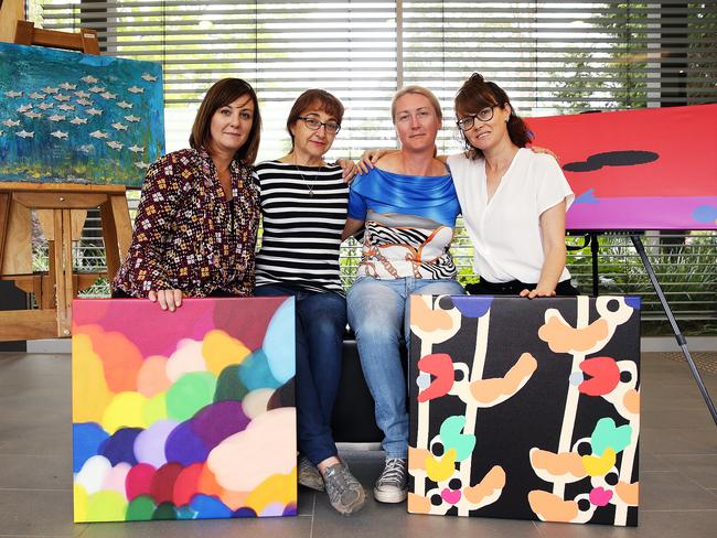 Friends of Maria Lutz's Peta Rostirola, Sarina Marchi, Nichole Brimble and Kerrie Dietz at St Lucy's school in Wahroonga with two pieces of Martin and Elisa's artwork. Picture: Sam Ruttyn
