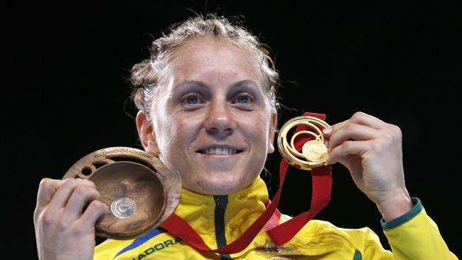 Australia's Shelley Watts poses on the podium after winning the gold medal in the women's light (57-60kg) final boxing bout at the 2014 Commonwealth Games in Glasgow.