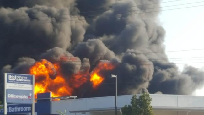 A fire behind Officeworks off Sandgate Rd, Virginia. Picture: Richard Waugh