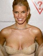 <p>Jessica Simpson suffers a classic nip slip when her cleavage escapes from her dress</p>