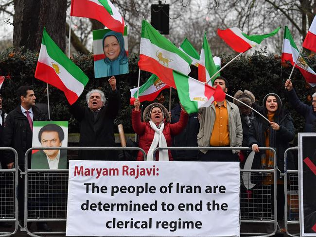 Protesters wave flags as they gather outside the Iranian Embassy in central London. Picture: AFP