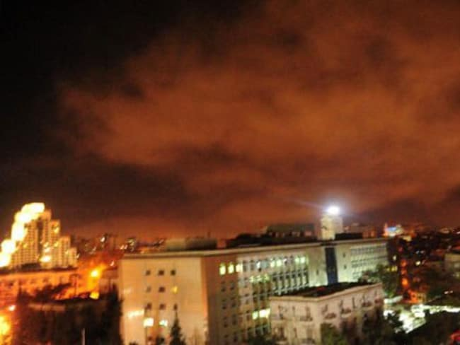 A photo from the Syrian government's central military media shows an explosion on the outskirts of Damascus after Western strikes reportedly hit Syrian military bases. Picture: Syrian government, AFP