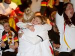 Lina Vasquez and Lilli Glinzner are delighted with Germany's win as they celebrate at the German Club. Picture: Simon Cross