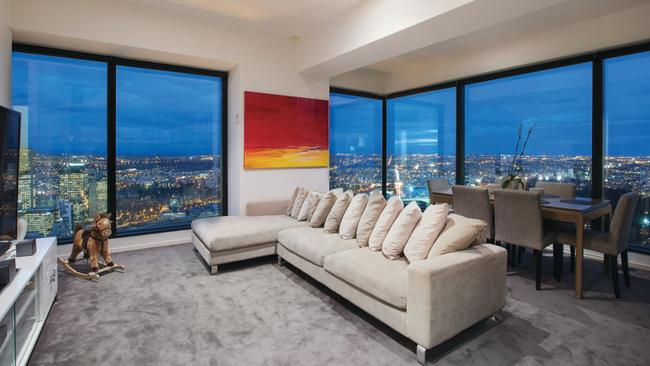 6304/7 Riverside Quay, Southbank. The open-plan living room and dining room combine to provide extensive window frontage