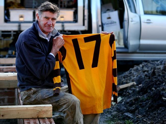 Michael Tuck was captured on a building site with his jumper from the 1991 Hawthorn premiership and the last jumper he wore playing AFL football. Picture: Wayne Ludbey