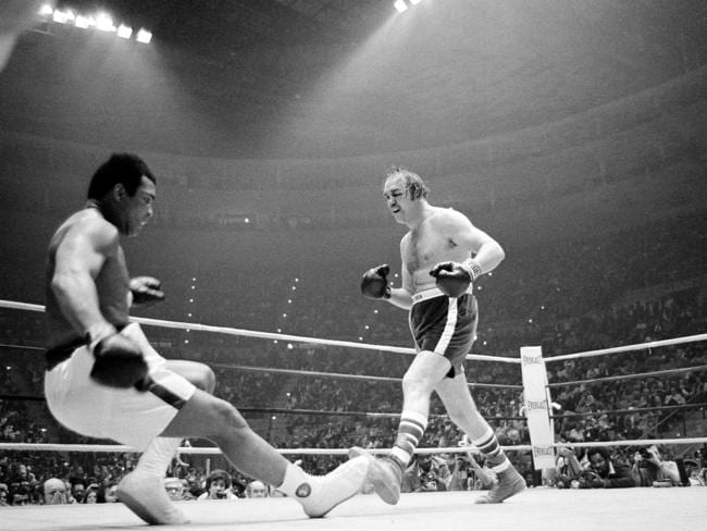 Muhammad Ali going down in the ninth round of the title bout against challenger Chuck Wepner in 1975. Picture: AP Photo