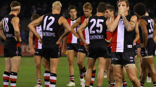 A dejected looking Saints side leaves the ground after losing the round seven AFL match between the St Kilda Saints and the Carlton Blues at Etihad Stadium on May 9, 2011 in Melbourne, Australia. (Photo by Quinn Rooney/Getty Images)