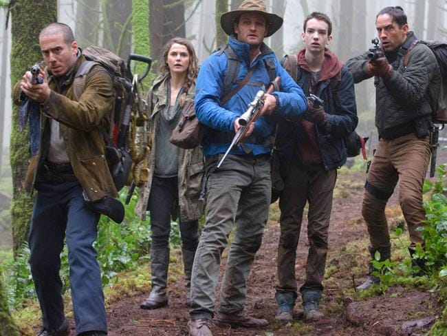Russell with Kirk Acevedo, Jason Clarke, Kodi Smit-McPhee and Enrique Murciano in a scene from the film.