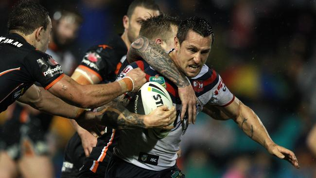 Mitchell Pearce under some early pressure from the Tigers.