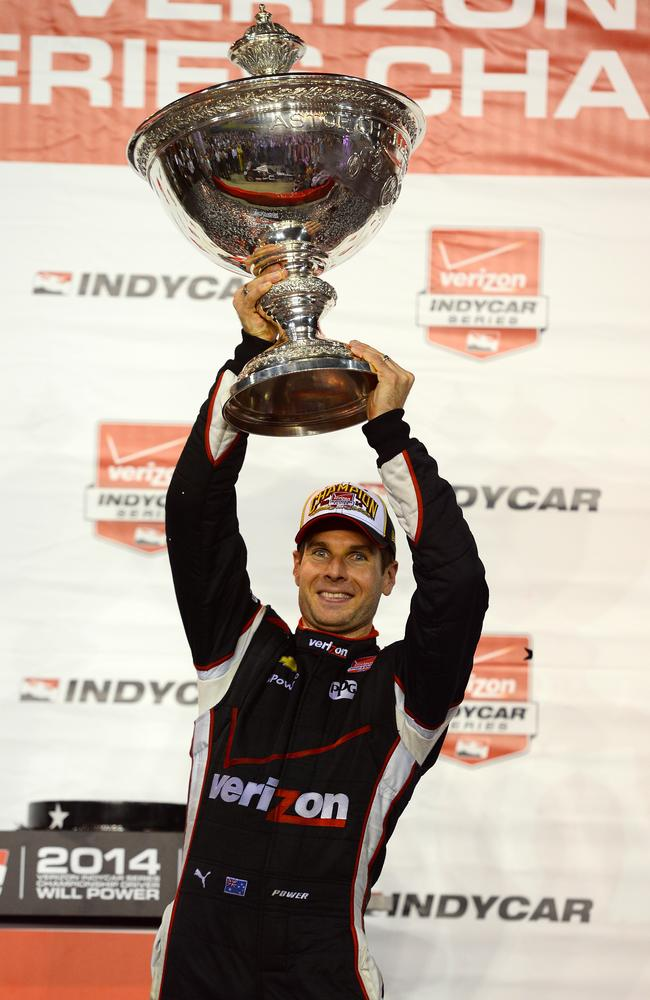Will Power celebrates after winning the IndyCar Championship.