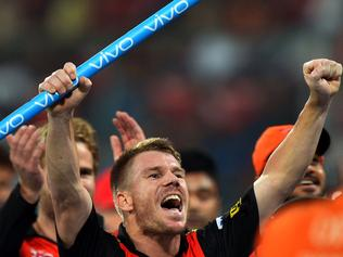 Sunrisers Hyderabad captain David Warner (C) gestures as he celebrates his team's victory against Royal Challengers Bangalore during the final Twenty20 cricket match of the 2016 Indian Premier League (IPL) between Royal Challengers Bangalore and Sunrisers Hyderabad at The M Chinnaswamy Stadium in Bangalore on May 29, 2016. / AFP PHOTO / MANJUNATH KIRAN / ----IMAGE RESTRICTED TO EDITORIAL USE - STRICTLY NO COMMERCIAL USE----- / GETTYOUT