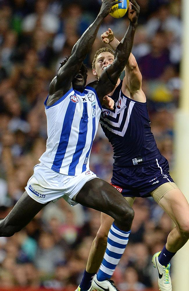 Majak Daw marks strongly in front of Zac Dawson