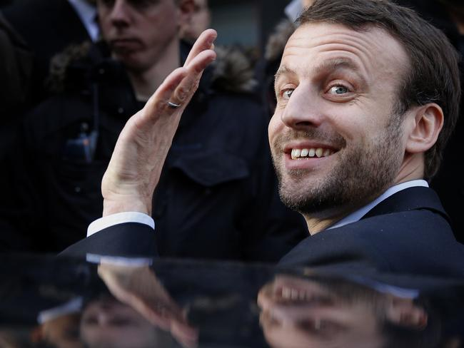 French Economy Minister Emmanuel Macron waves. Picture: AFP.