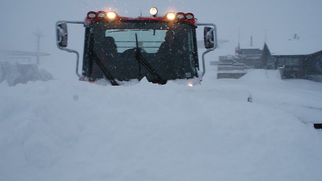 A groomer pushing snow at Mt Hutt in New Zealand after heavy falls this week. Picture: Supplied