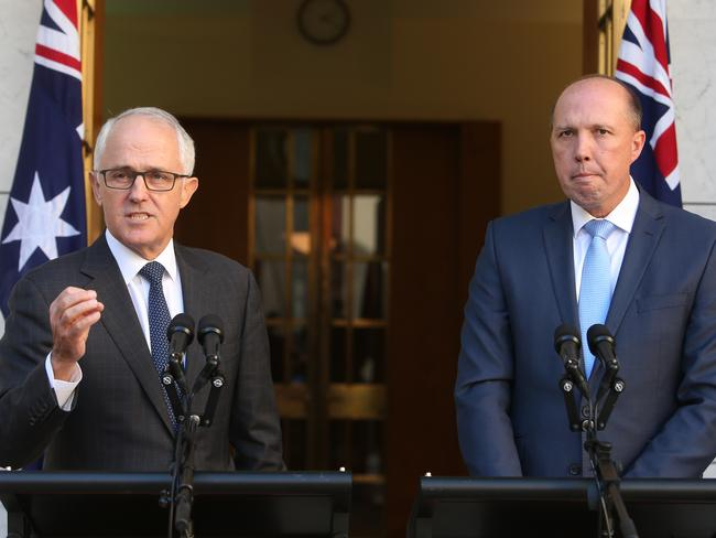 Malcolm Turnbull and Peter Dutton at Parliament House press conference announcing the visa changes. Picture Kym Smith