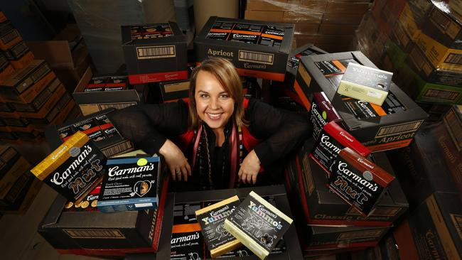 Recipe to Riches story ... people who turn their passion for food into a money making business. Carolyn Creswell from Carmens Muesli pictured with a huge pile of her boxed and packeted muesli