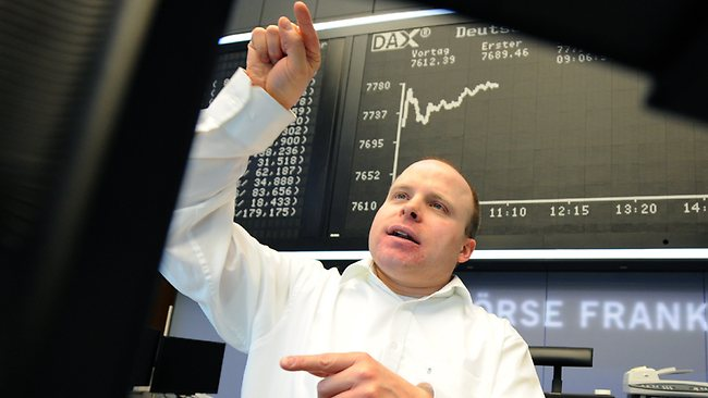 A broker views his monitor at the Stock Exchange in Frankfurt as financial markets worldwide eased after the United States averted the so-called fiscal cliff. Picture: AFP/ ARNE DEDERT
